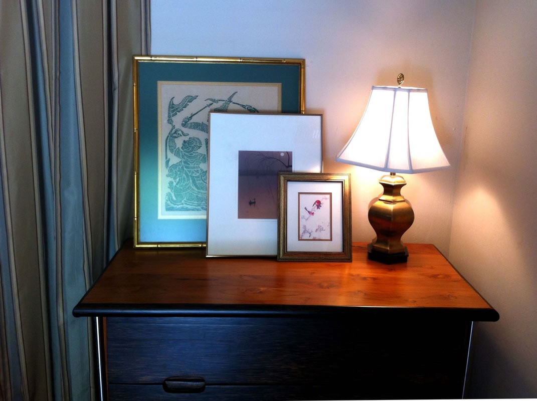 Resting art on surfaces keeps your walls hole free and allows you to frequently change art around your home.